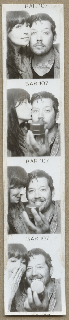 A boy proposing to a girl in a photobooth