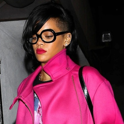 Rihanna shows off her new hairstyle while dressed in hot pink